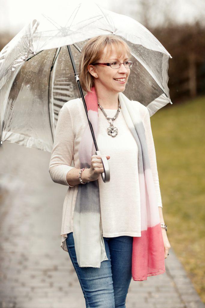 Clare Farthing under an umbrella
